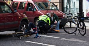 Cyclist and driver checking man injured in bike accident