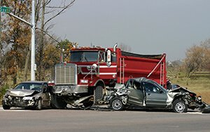 Motor vehicle accident involving dump truck and two cars