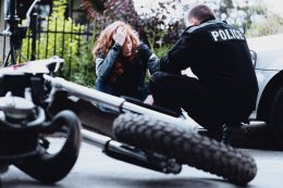 motorcyclist and policeman after accident