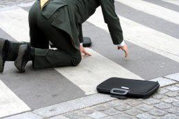 businessman falling on street