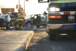 auto accident scene with fire medics