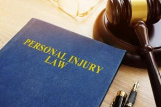 Gavel and personal injury law book