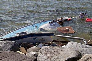Sailboat submerged after hitting rocks.