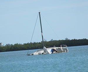 Capsized sailboat sinking.