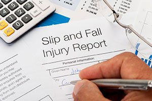 Manager filling out a slip and fall injury report.