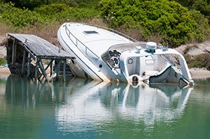 Speedboat crash into land by dock.