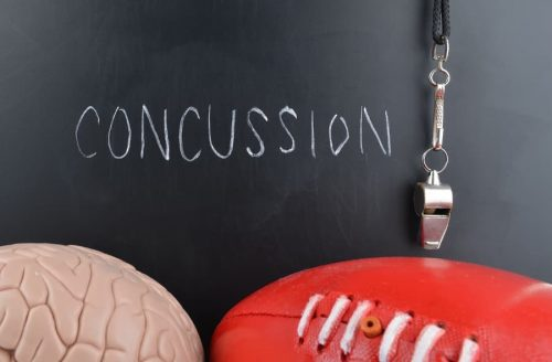 concussion written out with a brain and football