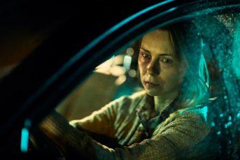 Injured woman in car